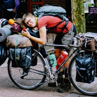 Greydiation in Lund Sweden hugging touring bike